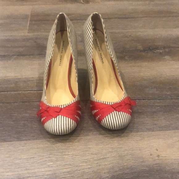 Gently worn striped shoes with Red bow detailing
